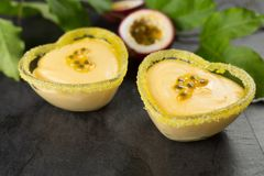 Passion fruit mousse on dark background, horizontal composition.  stock photos