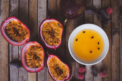 Passion fruit pulp and seed board, candied fruit, plate with jam Stock Photography