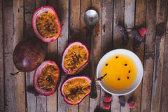 Passion fruit pulp and seed board, spoon, candied fruit, plate w Stock Photo