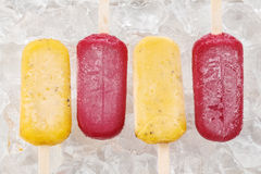 Passion fruit red grapes popsicle yummy fresh summer fruit sweet dessert. Passion fruit red grapes yummy fresh summer fruit sweet dessert on vintage old wood Stock Image