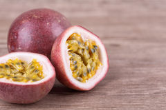 Passion fruit. Ripe passion fruit on a wooden background Stock Photo