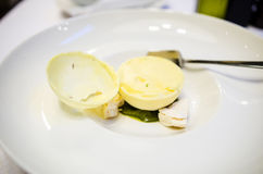 Passion fruit sorbetto. Passion fruit sorbet in a white chocolate sphere Royalty Free Stock Images