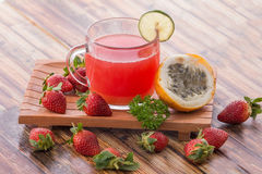 Passion fruit and strawberry smoothies Stock Photography