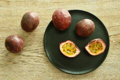 Passion fruit taste sweet and sour half cut on plate