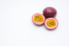 Passion fruit and two half isolated on a white. Royalty Free Stock Image