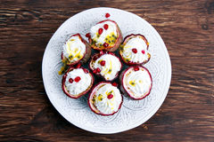 Passion fruit and whipped cream dessert with pomegranate seeds Royalty Free Stock Photography