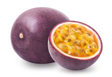 Passion fruit. Whole passionfruit and a half of maracuya isolated on white background. Clipping path included stock photos