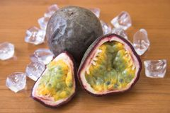 Passion fruits. Sliced & whole passion fruit Royalty Free Stock Photos