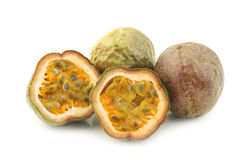Passion fruits and a cut one Royalty Free Stock Photography