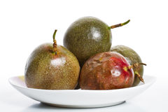 Passion fruits on dish Stock Photography
