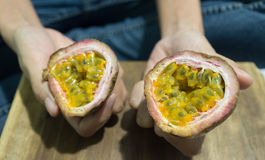 Passion fruits. Passion in a female hand Royalty Free Stock Photos