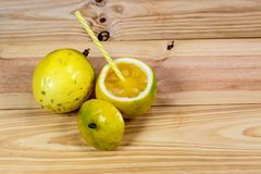 Passion fruits half and juice on the vintage wooden background. Closeup, Select focus stock images