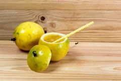 Passion fruits half and juice on the vintage wooden background royalty free stock photography