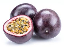 Passion fruits and its cross section with pulpy juice filled with seeds. White background. ÑŽ stock images