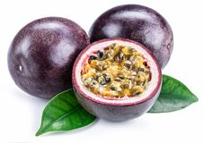 Passion fruits and its cross section with pulpy juice filled with seeds. White background. ÑŽ royalty free stock photo