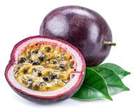 Passion fruits and its cross section with pulpy juice filled with seeds. White background.  royalty free stock photography