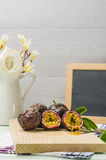 Passion fruits with leaves, knife and white flowers in jar Royalty Free Stock Image