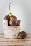 Passion fruits s on a wooden table Royalty Free Stock Image