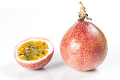 Passion fruits and slice on white Stock Images