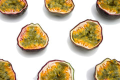 Passion fruits sliced. Rows of sliced passion fruit - white background. Great background image, check out my gallery for other food images Stock Photo