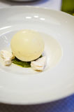 Passion fruits sorbett. Passion fruit sorbet in a white chocolate sphere Royalty Free Stock Image