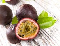 Passion fruits. On wooden background stock images