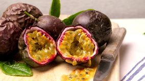 Passion fruits on wooden tray. On wooden table background stock video