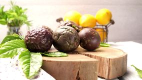 Passion fruits on wooden tray. On wooden table background stock footage