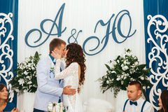 Passion kiss of just married at the dining table Stock Images