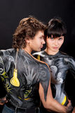 Passion look of caucasian body art model. Sensual calm caucasian couple with body art together over black Stock Image