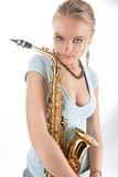 Passion look young blonde with saxophone Royalty Free Stock Photos