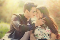 Passion and love. Couple. Harmony, tenderness, peace and love between two lovers. Young men and young women embracing outdoors. Intense feeling and fiery passion Royalty Free Stock Image