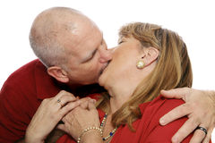 Passion in Marriage. Happy mature couple kissing passionately.  Isolated on white Royalty Free Stock Photo