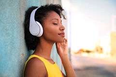 Passion for music. Portrait of a young girl listening music with her headphones royalty free stock photography