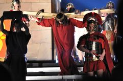 Passion play. Mystery of the Passion - Actors reenacting Christ carrying the Cross to his place of execution. Outdoor spectacle, directed by Artur Piotrowski Stock Photography