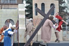 Passion play. Jesus carrying his cross, on the way to his crucifixion, during the street performances Mystery of the Passion on April 17, 2011 in Gora Kalwaria Royalty Free Stock Photo