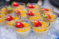 Passion pudding with strawberry on ice Stock Photography