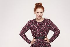 Passion and concept. Woman with ginger hair knot sticking o stock images