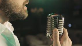 Passion singing in retro microphone in karaoke stock video footage