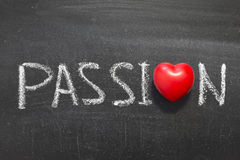 Passion. Word handwritten on chalkboard with heart symbol instead of O Stock Images