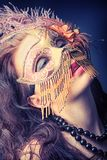 Passionate. Portrait of an attractive woman in mask posing at studio stock photography