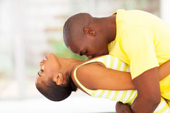 Passionate african couple. Passionate young african couple kissing stock image