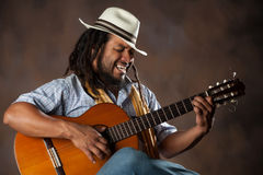 Passionate Afro Man Playing Guitar Royalty Free Stock Images