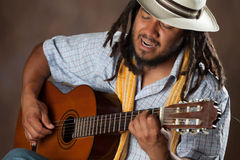 Passionate Afro Man Playing Guitar Stock Photo