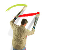 Passionate artist becoming one with his brushes Stock Image