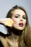 Passionate blonde woman portrait with orange Royalty Free Stock Images