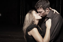 Passionate couple. Man holding a woman in his arms and kissing her passionately Stock Images
