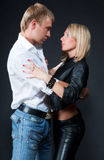 Passionate couple. Show their affection on a black royalty free stock photo