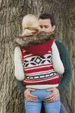 Passionate couple against tree trunk Royalty Free Stock Images