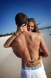 Passionate couple on beach. A passionate young couple enjoying their honeymoon on a beach royalty free stock photography